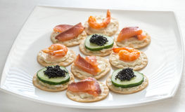 Canape with seafood on the plate Royalty Free Stock Image