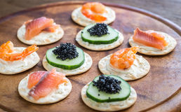 Canape with seafood on the wooden board Stock Image