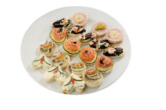 Canape selection. Party finger-food selection on white plate Royalty Free Stock Photo