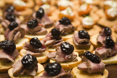Canape Selection. Prune, roast beef and sauce on crusted bread Stock Photo
