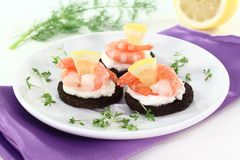 Canape with shrimps Stock Images