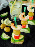 Canape on skewers Stock Photo