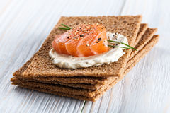 Canape with smoked salmon and crackers Royalty Free Stock Photo