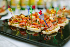 Canape. Snacks, s - table decoration for holiday Stock Photos
