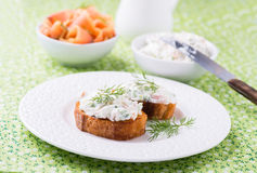 Canape with soft cheese spread on white plate Royalty Free Stock Images
