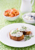 Canape with soft cheese spread on white plate Royalty Free Stock Photography