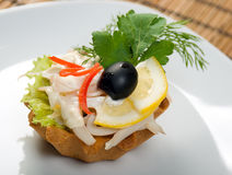 Canape with squids and lemon Stock Photography