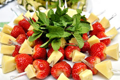 Canape with strawberry and cheese. Served with mint leaf Stock Image