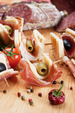Canape With Prosciutto And Olives Royalty Free Stock Photos