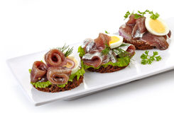 Canapes with anchovies and egg Royalty Free Stock Photography