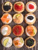 Canapes. Assortment of fresh canapes on board Royalty Free Stock Images