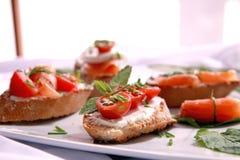 Canapes avec les saumons et le fromage Photographie stock