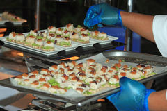 Canapes being arranged at a party, reception, wedding or celebration Royalty Free Stock Images