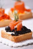 Canapes with black caviar, smoked salmon and dill Royalty Free Stock Photography