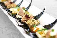 Canapes on black plastic spoons Royalty Free Stock Image