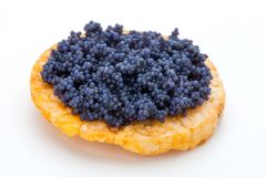 Canapes with black sturgeon caviar on the isolated white backgro Royalty Free Stock Images