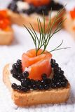Canapes with black sturgeon caviar and salmon fish Stock Photos