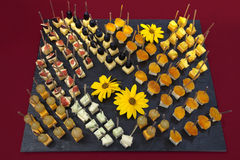 Canapes catering with fruit and cheese. Beautifully arranged on black dish Stock Photo