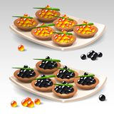 Canapes with caviar Royalty Free Stock Image