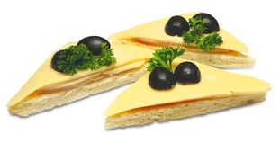 Canapes with cheese. Canapes with slices of cheese and black olives on a white background Royalty Free Stock Images