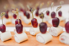 Canapes with cheese. Grapes closeup Stock Photo