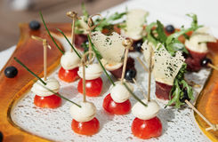 Canapes with cheese and ham Stock Images