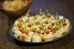 Canapes. With cheese and olives Royalty Free Stock Photography