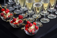 Canapes of cheese and strawberries with champagne Royalty Free Stock Photo