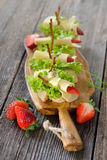 Canapes with cheese and strawberries Royalty Free Stock Images