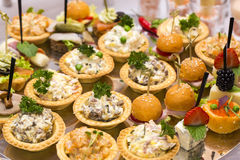 Canapes. Of cheese vegetables meat and seafood on white background Royalty Free Stock Image