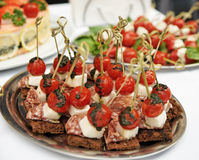 Canapes with choriso wurst on table Stock Images