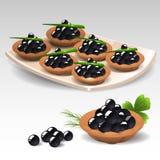 Canapes con el caviar negro Foto de archivo