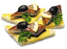 Canapes con la anguila fumada Imagen de archivo libre de regalías