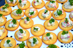Canapes. Crackers Canapes with vegetable salad on top on party table Royalty Free Stock Image