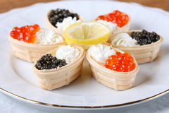 Canapes with cream cheese and caviar Stock Images