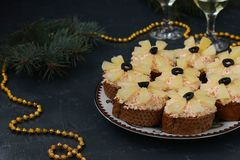 Canapes with cream cheese, crab sticks, black olives and pineapples stock images