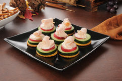 Canapes with cucumber, radish and cream cheese Royalty Free Stock Image