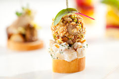 Canapes. Delicious Mushrooms Canapes over White Royalty Free Stock Photography