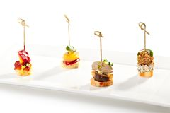 Canapes. Delicious Mushrooms Canapes over White Stock Photos