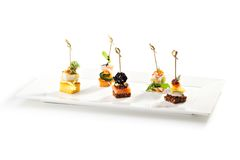 Canapes. Delicious Seafood and Vegetables Canapes Royalty Free Stock Photos