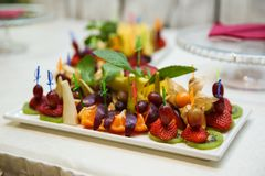 Canapes of different fruits and berries close up stock photos