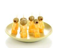 Canapes do queijo na placa Imagens de Stock Royalty Free