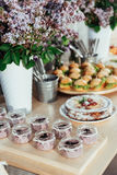 Canapes and drinks a desserts on the buffet table Royalty Free Stock Images