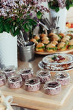Canapes and drinks a desserts on the buffet table Royalty Free Stock Photography