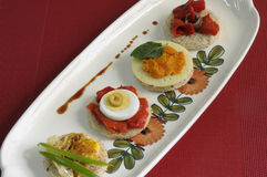 Canapes with eggs, peppers and pate. Tasty bread slices, with eggs, peppers and pate Stock Image