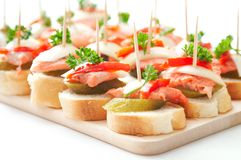 Canapes with fish Royalty Free Stock Image