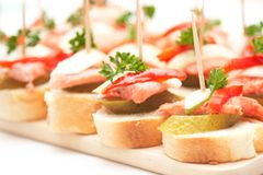 Canapes with fish Stock Photos