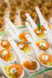 Canapes with fish and meat. Closeup royalty free stock photography