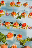 Canapes with fish and meat Royalty Free Stock Image