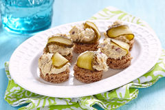 Canapes with fish pate and pickle Stock Image